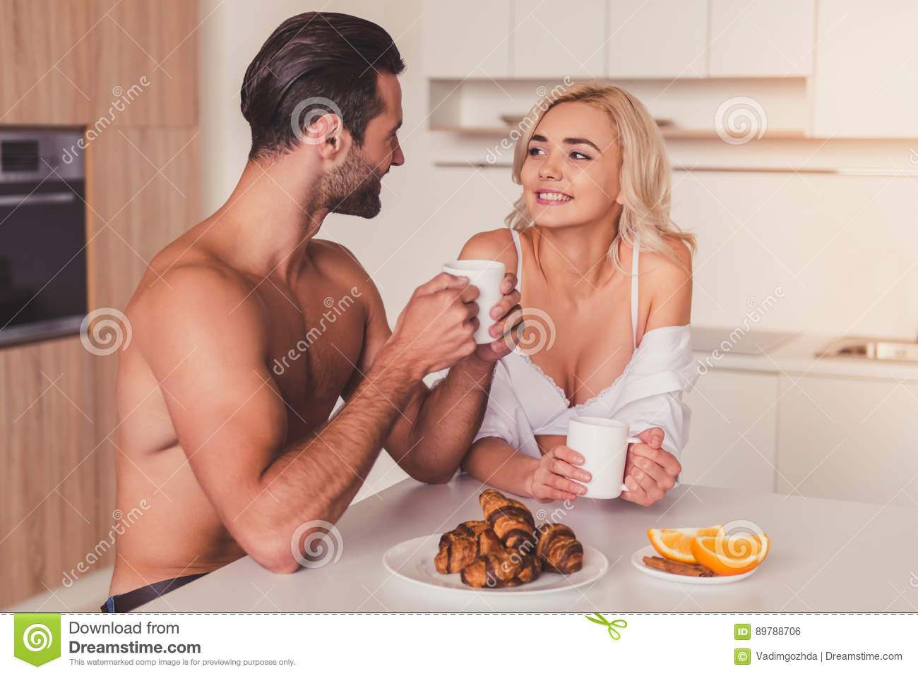 naked couple in the kitchen