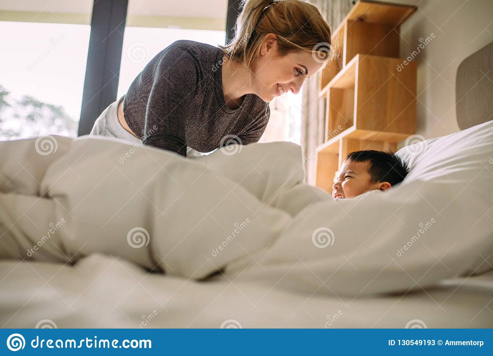 the real mom and son on the bed